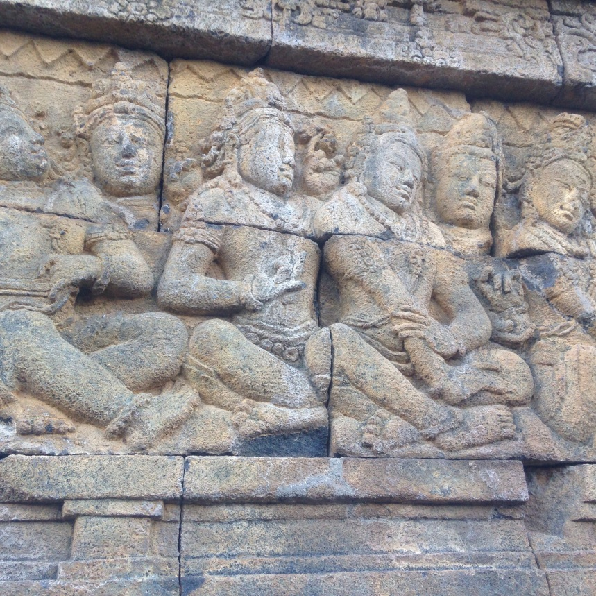 Carvings adorning the walls of Borobudur